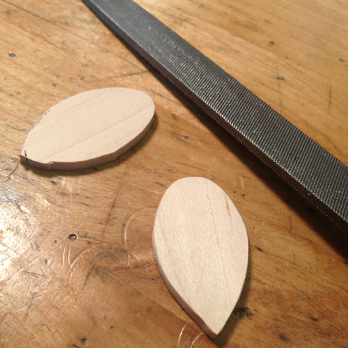 Refining wood jewelry shapes