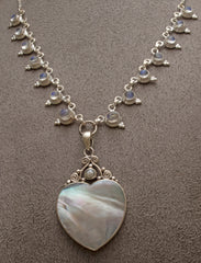 Heart shaped silver mother of pearl pendant on silver rainbow moonstone necklace