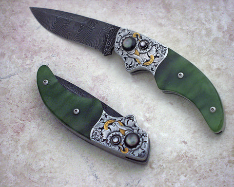 Engraved jade button lock folding knife