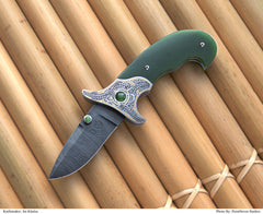 Engraved jade folding knife