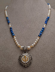Two-tone steel heart Adi Shakti pendant on freshwater pearl, lapis lazuli and carved clear quartz bead necklace