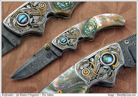 Engraved abalone handled folding knife