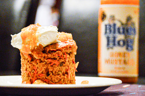 Piece of carrot cake with Honey mustard squeeze bottle