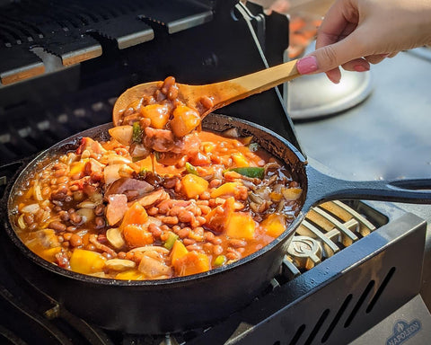 Beans in a skillet on the grill