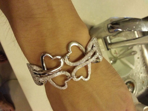 Four Heart Bracelet Accented with Diamond Cutting