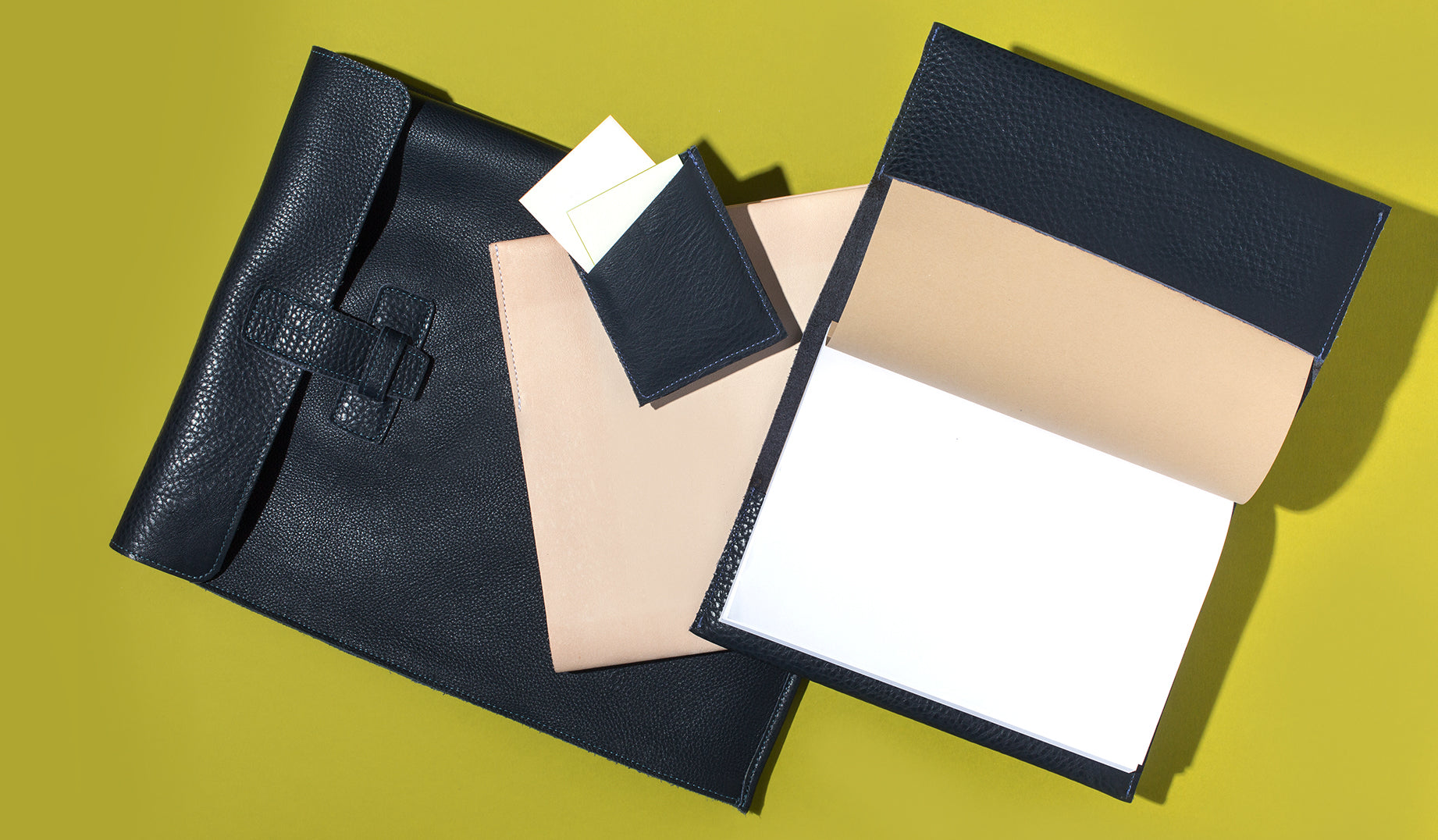 Supple materials and hand-stitched finishes make Agnes Baddoo's leather goods the perfect way to transport your print materials. Choose from three styles; folios, notebooks, or business card holders. All handmade in LA.