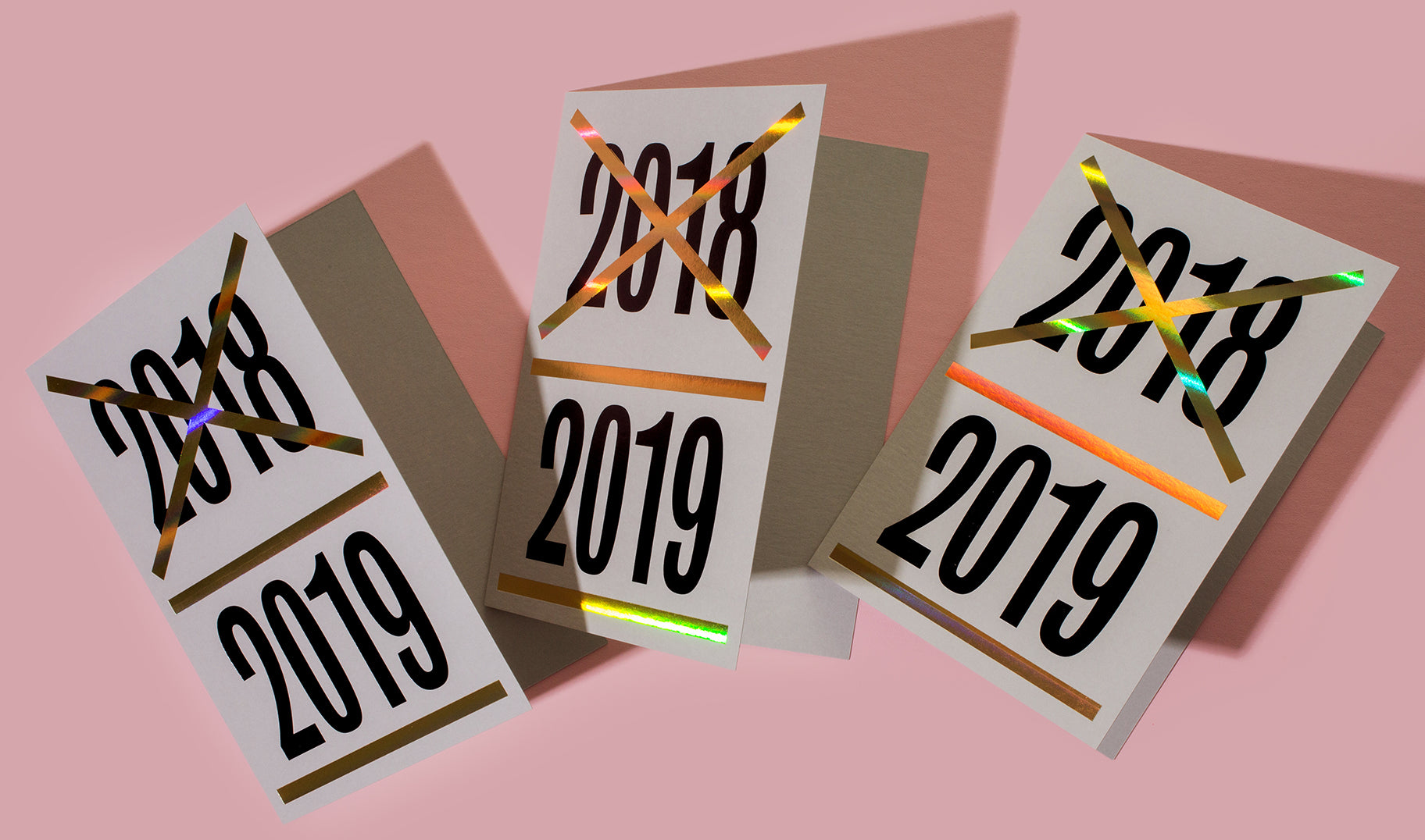Some say happy new year, some say onto the next! Featuring a combination of matte black and rainbow holographic foil stamps on pale grey Mohawk paper, these cards will bring a warm welcome to 2019.