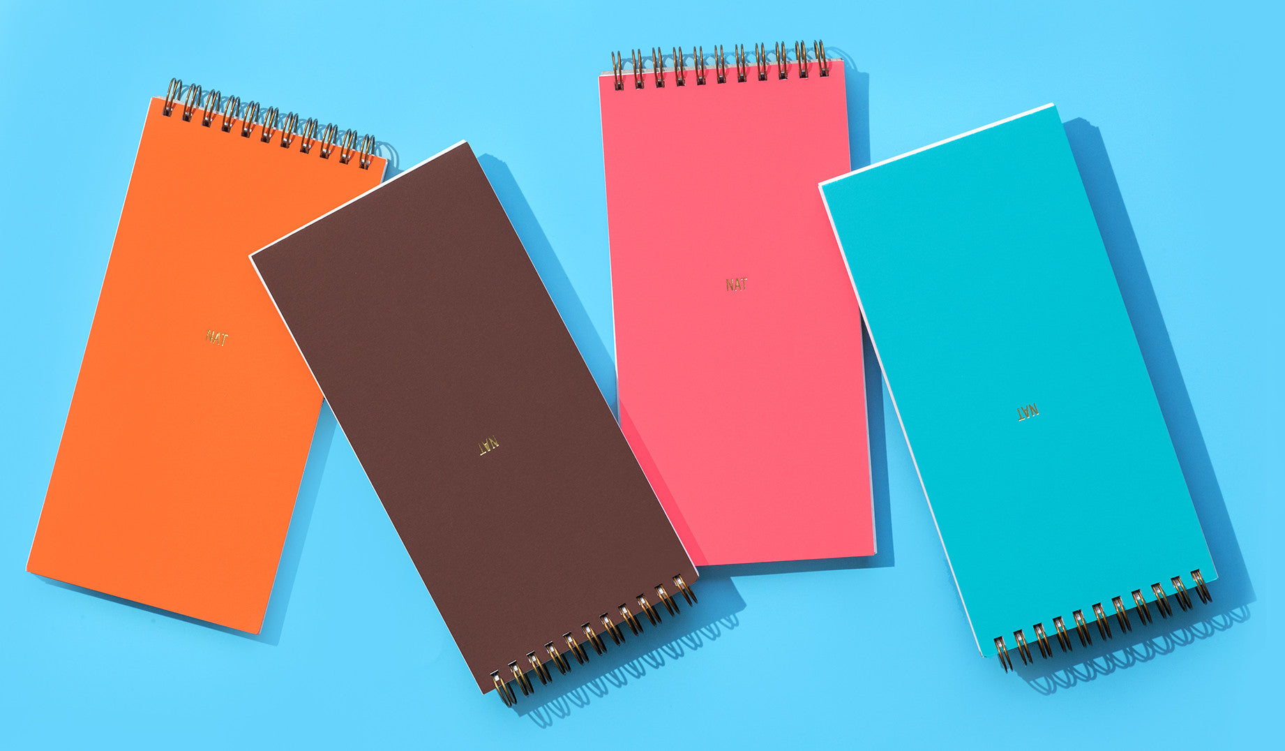 Based on the format of the traditional reporter's notebook, Commune's Designer's Notebooks add beauty to functionality with brightly colored covers in premium Astrobright papers and custom gold monogramming. Sold in sets of four with one each of Orbit Orange, Rocket Red, Terrestrial Teal, and Jupiter Java colored covers. Approximately 90 lined pages per notebook.