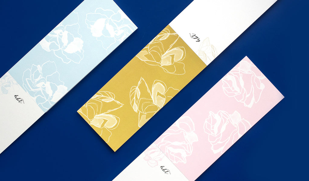 Utilizing the classic buckslip format, Heather Taylor Home brings artistry to this practical stationery item. With three hand drawn floral patterns in this season's signature colors; turmeric, pale blue, and dusty rose, these buckslips function perfectly as your canvas for notes, lists, or sketches. Personalize these with your own monogram and location. Thirty six buckslips on premium eco-friendly papers per pad.