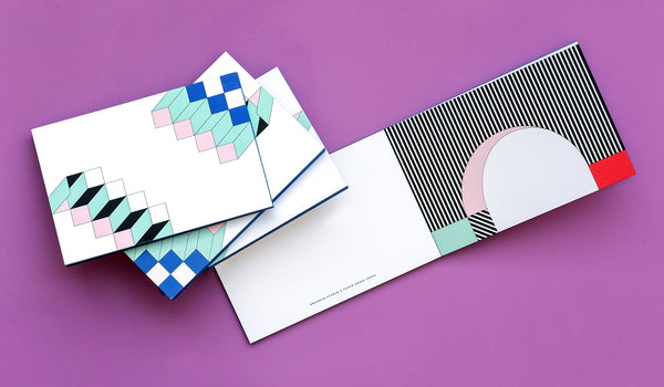 "This lively notepad from creative firm RoAndCo features nine distinct Memphis-inspired postcards printed on our classic double thick, bright white uncoated paper, with blue colored edges. <br/><br/>We sat down with Roanne Adams, RoAndCo Chief Creative Director, Founder and self-proclaimed ""Art Director, Big Picture Brand Thinker, Boss Lady, Client Therapist, Creative Collaborator, Design Critiquer, Entrepreneur, HR Manager, Public Speaker"" for a look into her world."