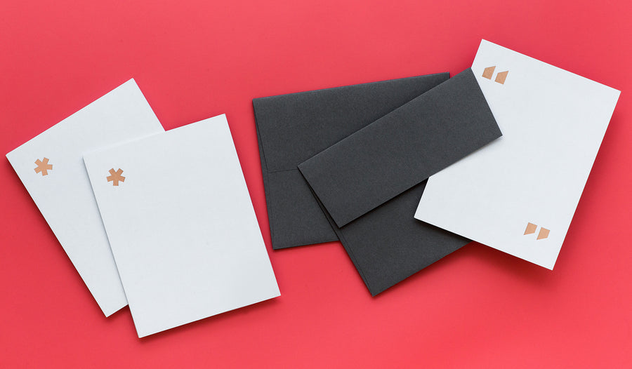 Simple elegance abounds in these notecard sets from fashion brand and retailer Everlane. Featuring double thick grey paper with rose gold foil stamping in three graphic options including quotation marks, parentheses, and an asterisk, these cards will frame any note in refinement. Sold in sets of ten cards with charcoal grey envelopes.