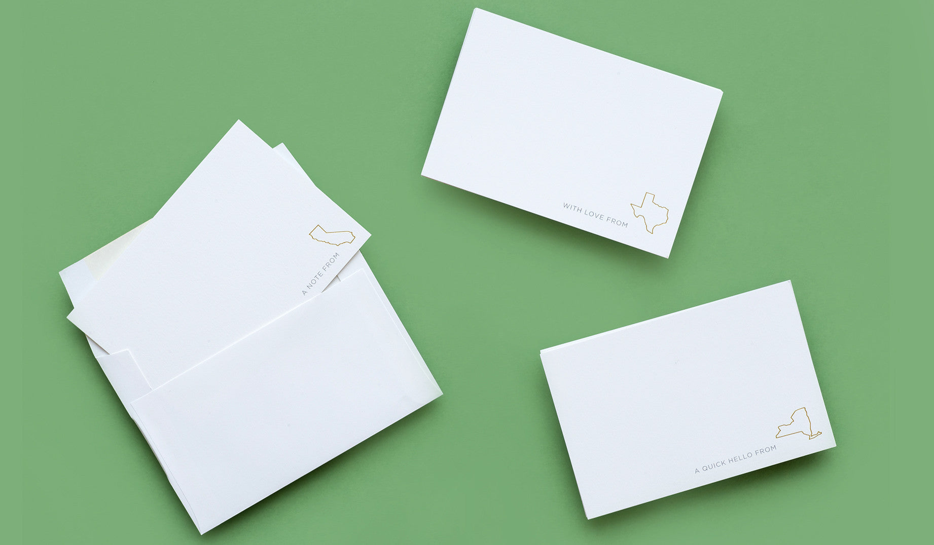 Introducing the State Series by jeweler Maya Brenner. Choose from three states stamped in rich gold foil onto our signature, double-thick eggshell card stock and bundled with matching envelopes. Create classic correspondence on these elegant cards to remind their recipients that it ain't where you're from, it's where you're at.