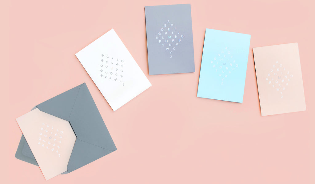 Send a letter with Maya Brenner's Letter Series Notecards. Each set includes 2 each of 4 color ways with matching grey envelopes. Highlight the letter of your choice to personalize these iconic cards.