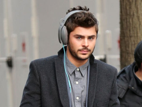 Zac Efron Using Skullcandy Headphones on the Street