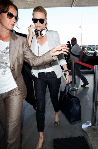 Charlize Theron Wearing Skullcandy Headphones