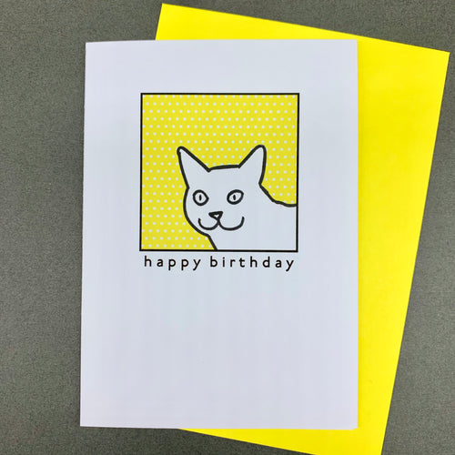 Cat on yellow polka dots
