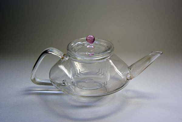 300ml glass tea pot with removable glass tea strainer. Made of borosilicate glass.