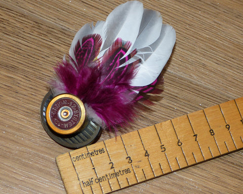 Feather Brooch or Hat Pin set in cartridge case head.