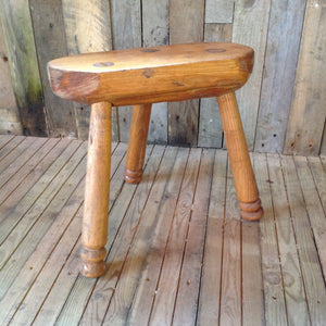 Rustic three-legged stool