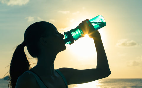 Girl Athlete Drinking from Bottle