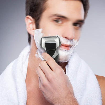 Electric Shaver With Flexible Pivoting Head