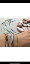 Load image into Gallery viewer, Stackable gold/silver tube bracelets.