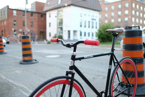 The Baron Regal Bicycle's Red and Black Bicycle in an Urban Setting