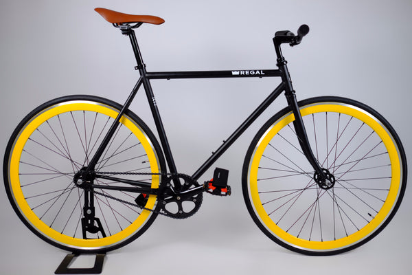 Yellow Rims and Black Frame on this Fixie Bike by Regal Bicycles Called the Hornet