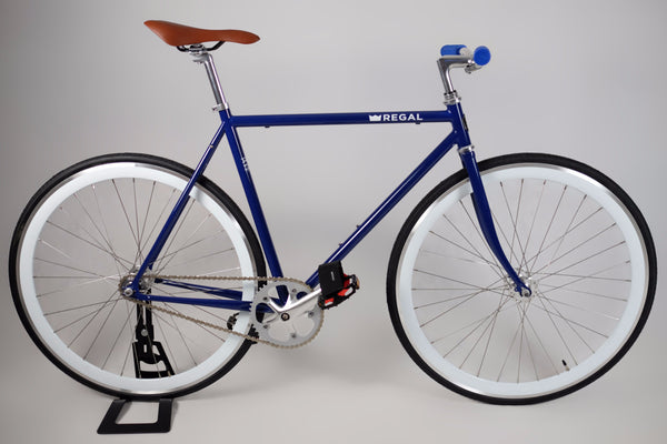 Fixie Bike and Single Speed Bike with Blue Rims and a White Frame