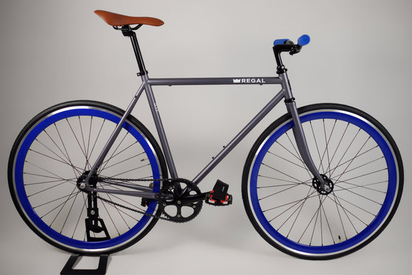 Matte Gray frame with Deep Blue Rims, the hubs are high flange flip flop for fixed gear and single speed riding.