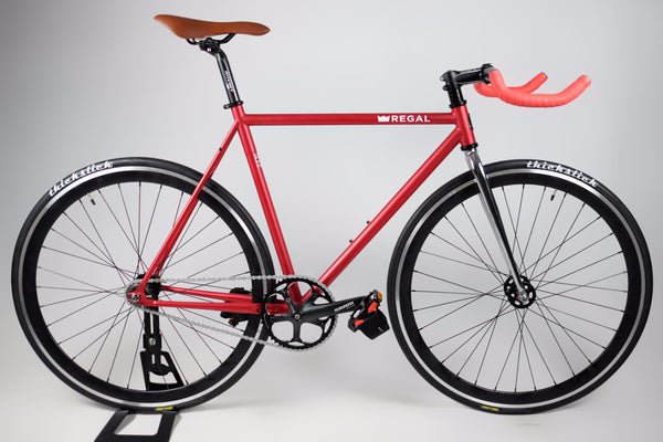 Fixie Bike with Matte Red Frame and Deep Black Rims, comes with a flip flop hub for single speed and fixed gear riding.