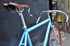 Picture of Regal Bicycles bike the Marquise with a light blue frame and red rims, built for speed