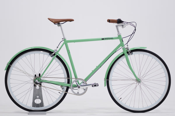 City Bike by Regal Bicycles with a Mint Green Frame and White Wall Rims, featuring a Shimano Nexus 3 Speed Internal Gear Hub built for commuting