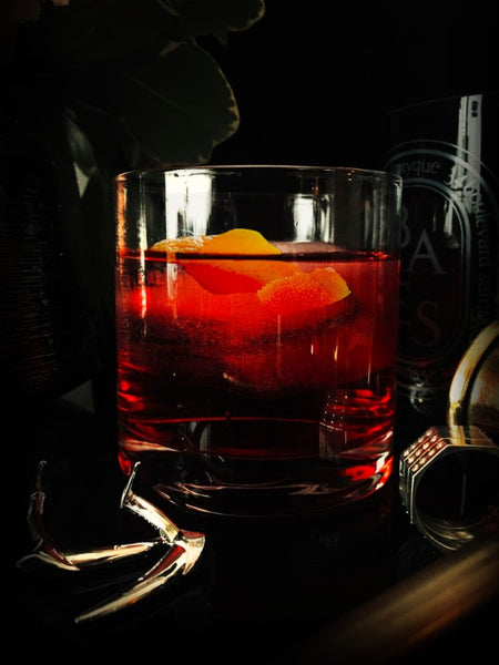 Mezcal Negroni and Marei Jewelry