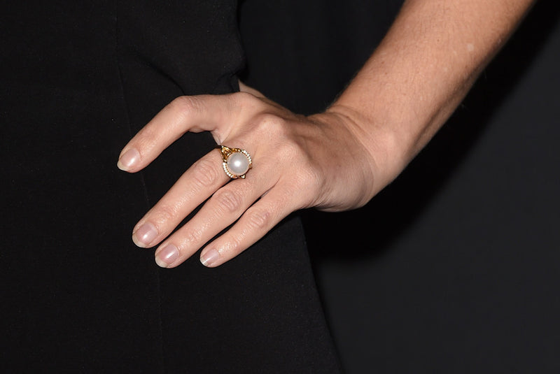 Actress Gillian Anderson wears Isis Goddess Ring by jewelry designer Angie Marei
