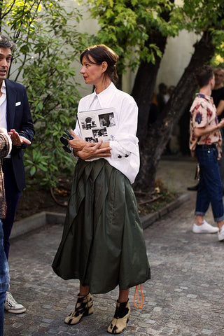 white shirt paired with olive green full skirt