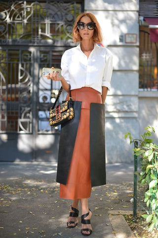 white shirt with panel leather skirt