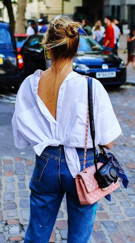 white shirt worn on back, knotted at waist