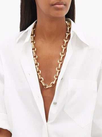 accessorise white shirt with gold chain necklace