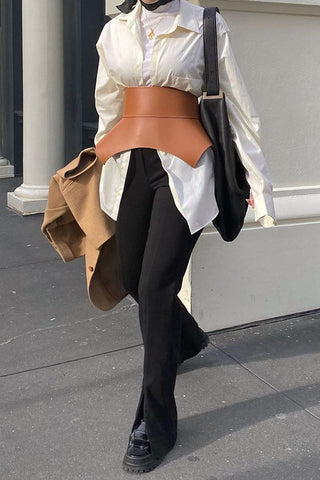 multi layering with ivory shirt and tanned statement belt