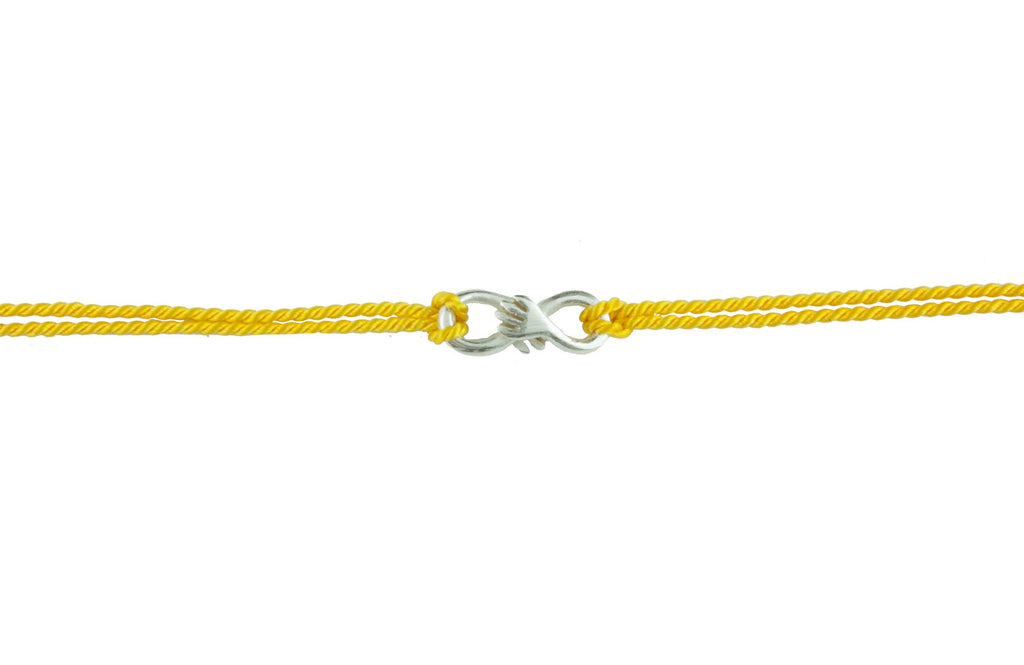 Cuddle charm bracelet on yellow silk thread