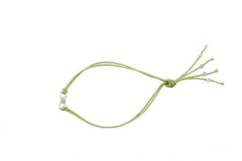 Cuddle charm bracelet on Apple green silk thread