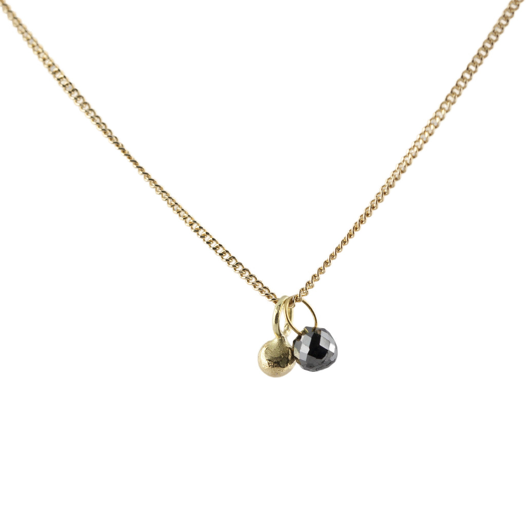 Delicate gold chain with 18ct granule and black diamond