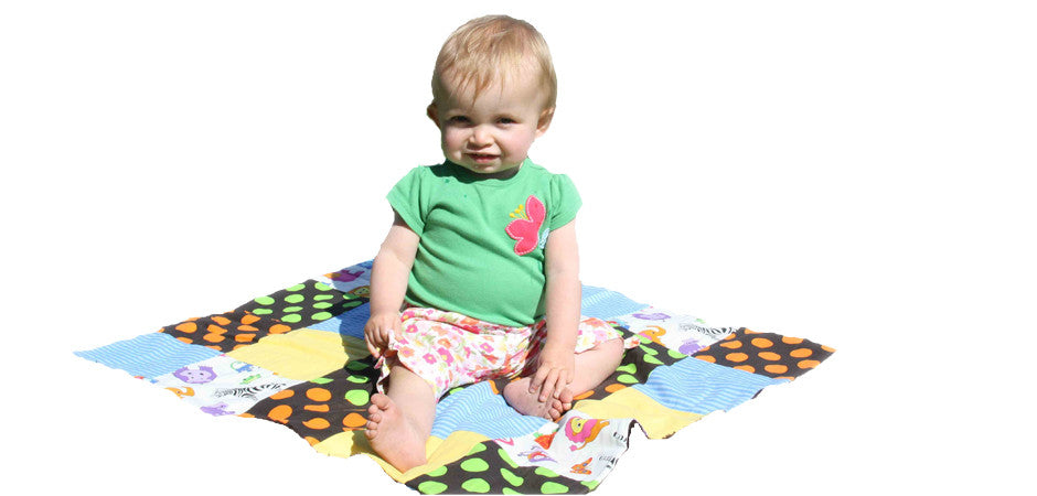 Sitting Toddler Lily on blanket