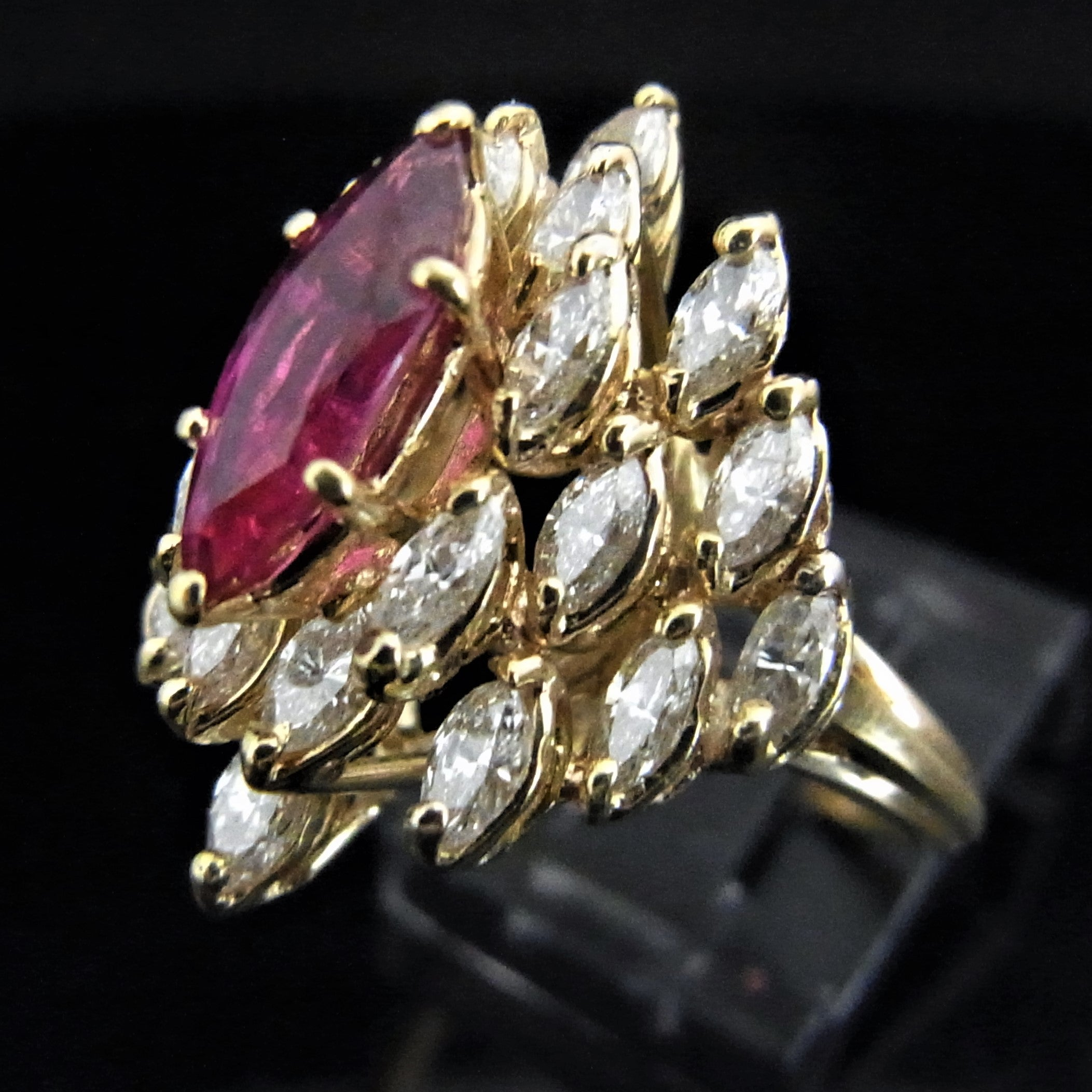 central graff ring ruby view collections bombe front of a bomb surrounded diamond pavilion pear shape featuring and top