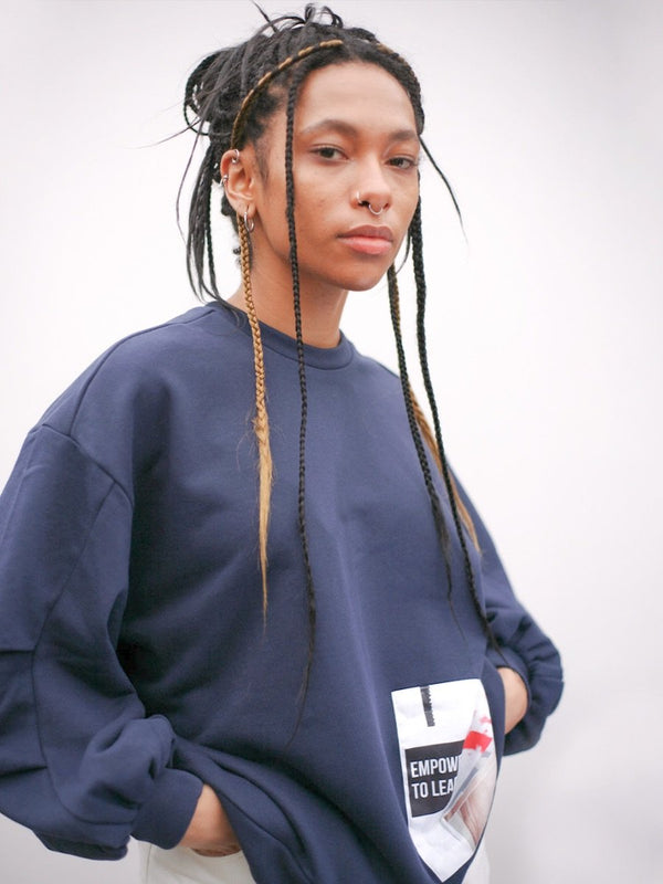 Navy oversized organic cotton jumper with oversized pleated sleeves and sustainable patches. Made by ethical clothing brand Fanfare Label.?id=15373212418101