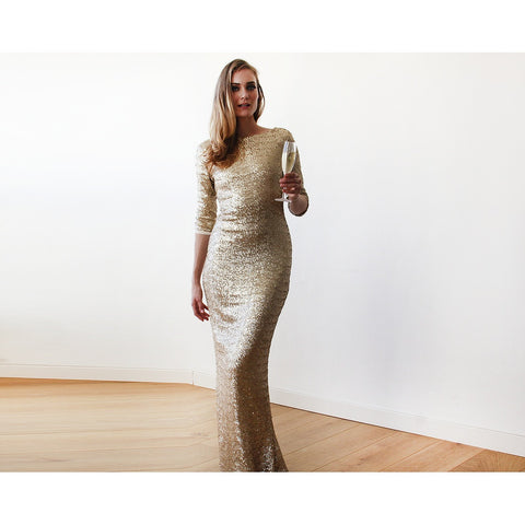 Gold backless maxi sequined gown with 3/4 sleeves