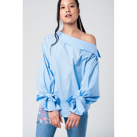 Blue cold shoulder shirt with laced cuffs