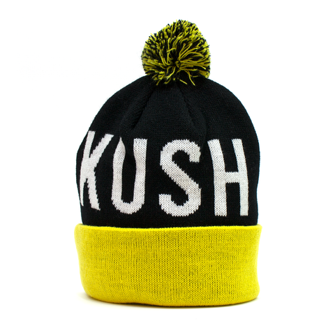 soft black and yellow weed pom beanie