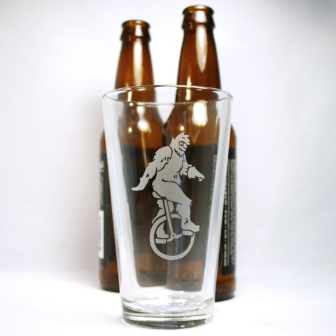 sasquatch pint glass with beer bottles